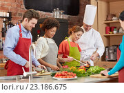 Купить «happy friends and chef cook cooking in kitchen», фото № 23186675, снято 12 февраля 2015 г. (c) Syda Productions / Фотобанк Лори