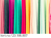 Купить «colorful textile at asian street market», фото № 23186807, снято 7 февраля 2015 г. (c) Syda Productions / Фотобанк Лори