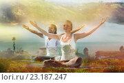 Купить «smiling couple making yoga exercises outdoors», фото № 23187247, снято 6 августа 2014 г. (c) Syda Productions / Фотобанк Лори