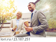 Купить «smiling businessmen with paper cups outdoors», фото № 23187251, снято 19 августа 2014 г. (c) Syda Productions / Фотобанк Лори