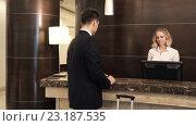 Купить «Businessman at reception», видеоролик № 23187535, снято 29 июня 2016 г. (c) Raev Denis / Фотобанк Лори