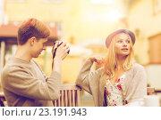 Купить «couple taking photo picture in cafe», фото № 23191943, снято 6 сентября 2013 г. (c) Syda Productions / Фотобанк Лори