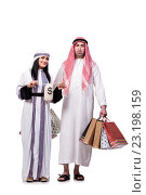 Купить «Happy arabic family after shopping isolated on white», фото № 23198159, снято 27 мая 2016 г. (c) Elnur / Фотобанк Лори