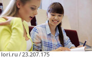 Купить «group of students with notebooks in lecture hall», видеоролик № 23207175, снято 23 июня 2016 г. (c) Syda Productions / Фотобанк Лори