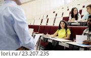 Купить «group of students and teacher in lecture hall», видеоролик № 23207235, снято 24 июня 2016 г. (c) Syda Productions / Фотобанк Лори