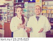 Купить «Two pharmacists in chemist shop», фото № 23215023, снято 16 ноября 2019 г. (c) Яков Филимонов / Фотобанк Лори