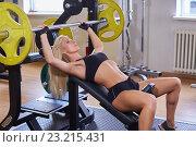 Купить «Sports woman in the gym.», фото № 23215431, снято 30 августа 2014 г. (c) Мельников Дмитрий / Фотобанк Лори