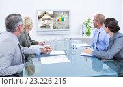 Купить «Composite image of business team looking at time clock», фото № 23226215, снято 10 июля 2020 г. (c) Wavebreak Media / Фотобанк Лори
