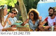 Купить «Group of hipster friends having a picnic», видеоролик № 23242735, снято 14 декабря 2018 г. (c) Wavebreak Media / Фотобанк Лори