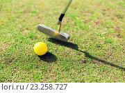 Купить «close up of club and ball near hole on golf field», фото № 23258727, снято 30 августа 2015 г. (c) Syda Productions / Фотобанк Лори