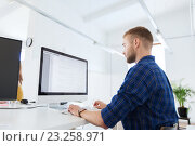 Купить «creative man or programmer with computer at office», фото № 23258971, снято 27 февраля 2016 г. (c) Syda Productions / Фотобанк Лори