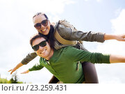 Купить «happy couple with backpacks having fun outdoors», фото № 23259431, снято 27 мая 2016 г. (c) Syda Productions / Фотобанк Лори