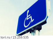 Купить «close up of road sign for disabled outdoors», фото № 23259535, снято 5 ноября 2015 г. (c) Syda Productions / Фотобанк Лори
