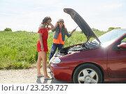 Купить «women with open hood of broken car at countryside», фото № 23259727, снято 28 мая 2016 г. (c) Syda Productions / Фотобанк Лори
