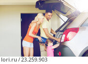 Купить «happy family packing things to car at home parking», фото № 23259903, снято 11 августа 2015 г. (c) Syda Productions / Фотобанк Лори