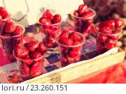 Купить «strawberry in plastic cups at street market», фото № 23260151, снято 7 февраля 2015 г. (c) Syda Productions / Фотобанк Лори