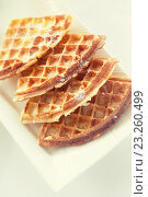 Купить «close up of waffles on plate at breakfast table», фото № 23260499, снято 23 февраля 2015 г. (c) Syda Productions / Фотобанк Лори