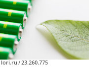 Купить «close up of green alkaline batteries», фото № 23260775, снято 3 июня 2016 г. (c) Syda Productions / Фотобанк Лори