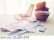 Купить «close up of baby clothes and toys for newborn», фото № 23261015, снято 25 мая 2016 г. (c) Syda Productions / Фотобанк Лори