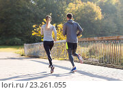 Купить «couple running or jogging outdoors», фото № 23261055, снято 17 октября 2015 г. (c) Syda Productions / Фотобанк Лори