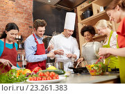 Купить «happy friends and chef cook cooking in kitchen», фото № 23261383, снято 12 февраля 2015 г. (c) Syda Productions / Фотобанк Лори