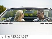 Купить «happy man and woman driving in cabriolet car», фото № 23261387, снято 15 июля 2015 г. (c) Syda Productions / Фотобанк Лори