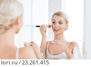 woman with makeup brush and powder at bathroom. Стоковое фото, фотограф Syda Productions / Фотобанк Лори