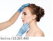 Купить «surgeon or beautician hands touching woman face», фото № 23261443, снято 14 апреля 2016 г. (c) Syda Productions / Фотобанк Лори