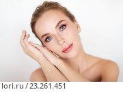 Купить «beautiful young woman face and hands», фото № 23261451, снято 14 апреля 2016 г. (c) Syda Productions / Фотобанк Лори
