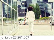Купить «african american businesswoman walking in city», фото № 23261567, снято 8 июля 2015 г. (c) Syda Productions / Фотобанк Лори