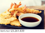 Купить «close up of deep-fried shrimps and soy sauce», фото № 23261839, снято 15 февраля 2015 г. (c) Syda Productions / Фотобанк Лори