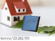 Купить «close up of house model and solar battery or cell», фото № 23262151, снято 3 июня 2016 г. (c) Syda Productions / Фотобанк Лори