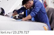 Купить «mechanic man with wrench repairing car at workshop 53», видеоролик № 23270727, снято 8 июля 2016 г. (c) Syda Productions / Фотобанк Лори