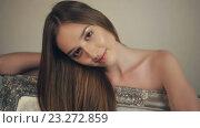 Купить «Красивая девушка с длинными волосами со старинной картиной», видеоролик № 23272859, снято 14 июля 2016 г. (c) Илья Шаматура / Фотобанк Лори