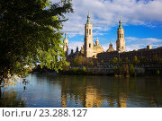 Купить «Cathedral of Our Lady of the Pillar in sunny evening. Zaragoza», фото № 23288127, снято 21 апреля 2016 г. (c) Яков Филимонов / Фотобанк Лори