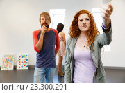 Young artists in gallery hanging painting on walls, фото № 23300291, снято 24 января 2015 г. (c) Sergey Nivens / Фотобанк Лори