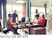 Купить «happy creative team in office», фото № 23301019, снято 29 марта 2015 г. (c) Syda Productions / Фотобанк Лори