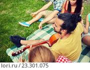 Купить «happy man with friends playing guitar at camping», фото № 23301075, снято 25 июля 2015 г. (c) Syda Productions / Фотобанк Лори