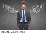 Купить «smiling businessman with angel wings and nimbus», фото № 23301083, снято 14 февраля 2014 г. (c) Syda Productions / Фотобанк Лори