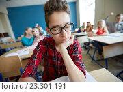 Купить «students gossiping behind classmate back at school», фото № 23301191, снято 22 апреля 2016 г. (c) Syda Productions / Фотобанк Лори