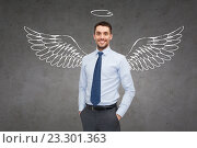 Купить «smiling businessman with angel wings and nimbus», фото № 23301363, снято 14 февраля 2014 г. (c) Syda Productions / Фотобанк Лори