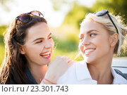 Купить «happy women or teenage girls laughing outdoors», фото № 23301743, снято 7 июня 2016 г. (c) Syda Productions / Фотобанк Лори