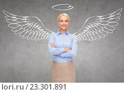 Купить «happy businesswoman with angel wings and nimbus», фото № 23301891, снято 14 февраля 2014 г. (c) Syda Productions / Фотобанк Лори