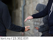 Купить «close up of addict buying dose from drug dealer», фото № 23302031, снято 9 июня 2016 г. (c) Syda Productions / Фотобанк Лори