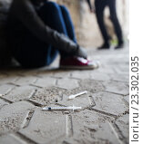Купить «close up of addicts and drug syringes on ground», фото № 23302035, снято 9 июня 2016 г. (c) Syda Productions / Фотобанк Лори