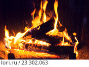 Купить «close up of firewood burning in fireplace», фото № 23302063, снято 16 октября 2015 г. (c) Syda Productions / Фотобанк Лори