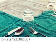 Купить «close up of cutlery with glass and napkin on table», фото № 23302067, снято 15 февраля 2015 г. (c) Syda Productions / Фотобанк Лори