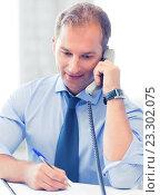 Купить «handsome businessman talking on the phone», фото № 23302075, снято 9 июня 2013 г. (c) Syda Productions / Фотобанк Лори