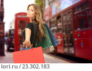 Купить «woman with shopping bags over london city street», фото № 23302183, снято 14 августа 2010 г. (c) Syda Productions / Фотобанк Лори