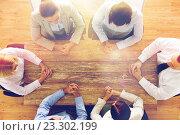 Купить «close up of business team sitting at table», фото № 23302199, снято 10 октября 2014 г. (c) Syda Productions / Фотобанк Лори